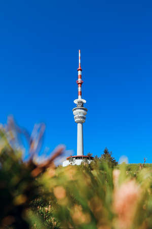 Praded lookout tower and television transmitter - the highest mountain of Hruby Jesenik in northern Moravia in the Czech Republic. Beautiful circular tower with a height of over 100m. Stock Photo