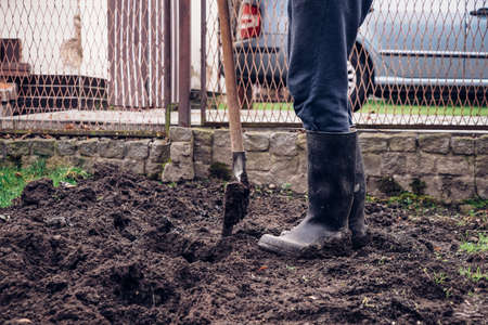 Heavy manual work with a spade and a shovel with wet dirt. The young player takes care of his land and tries to improve its liveability. It provides the necessary nutrients and blood flow.