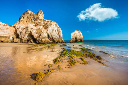 Low tide at beautiful rocky beach - Praia Dos Tres Irmaos, Algarve region, Portugal Stock Photo