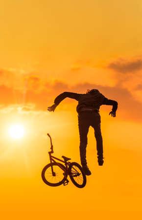 Man drops bmx bike mid-air