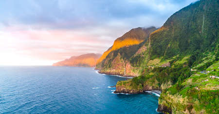 North coast of Madeira with Veu da Noiva waterfall on a sunny afternoon 写真素材
