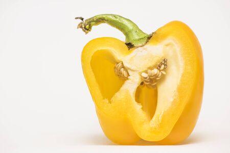 slice yellow pepper on white background macro Stock Photo