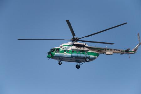 Novosibirsk, Russia - February 14, 2018: Helicopter Mil Mi-8MTV-1 Hip RF-38366 in the sky near Tolmachevo International Airport Stock Photo - 105118062