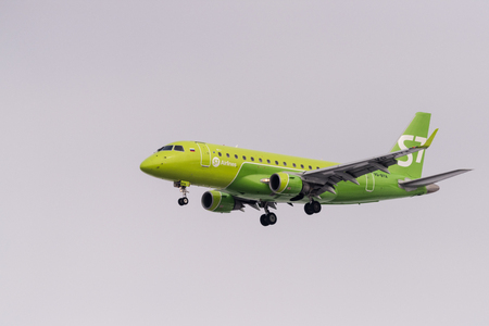 Novosibirsk, Russia - March 10, 2018: Embraer 170-100SU VQ-BYA S7 airlines approaches for landing at the international airport Tolmachevo.