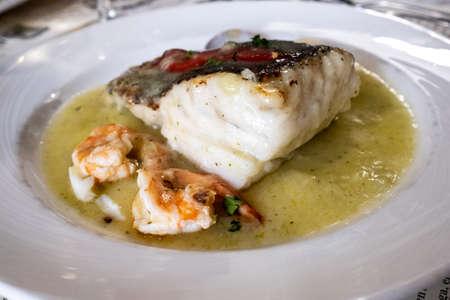 Hake dish with prawns and clams Stock Photo