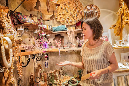 Woman looking at jewelry inside a store Stock fotó