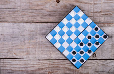 small checkers game on a blue board