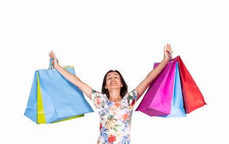 young woman looking up with shopping bags on white background