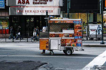 NEW YORK, USA. February 2009. hot dog stand crossing an avenue of manhattan