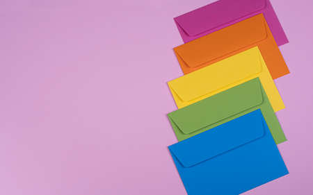 tidy coloured envelopes on a light pink background