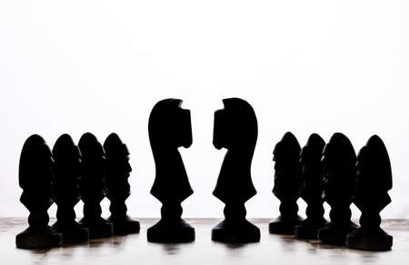 silhouettes of chess pieces on a white background