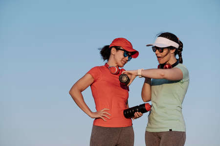 women looking at their watch after training 免版税图像
