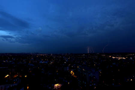 Multiple lightning strikes over a big city by night - in Belgrade, Serbia photo