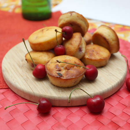 Cherry ricotta muffins served on a wooden plate Stockfoto