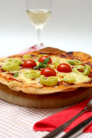 Homemade Pizza with Cheese, Salami, Tomato photo