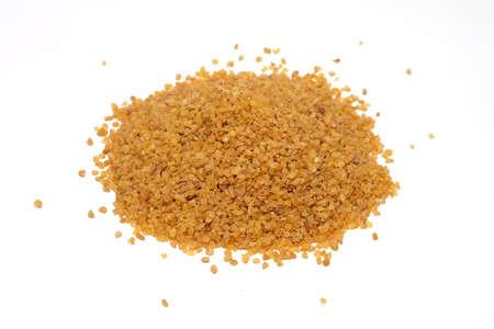 Bulgur grains pile isolated on white background