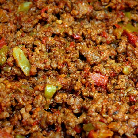 Minced meat with vegetables and spices Standard-Bild