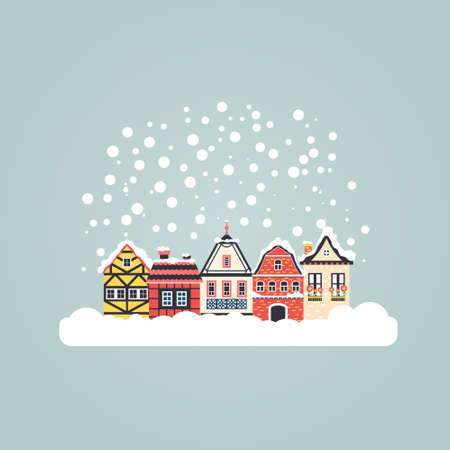 urban scene: Winter scene with an european city and snow. Beautiful houses covered with snow. Xmas concept made