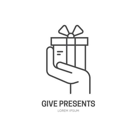 philanthropy: Hand holding a present - symbol for charity or donation event.