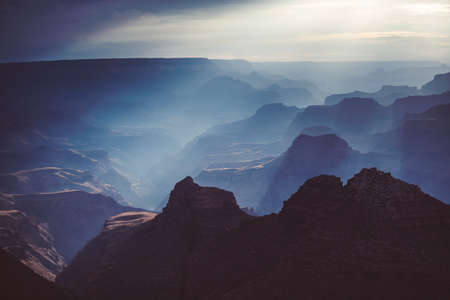 Sunset in the Grand Canyon national park, USA. Light going through the clouds. Stock Photo