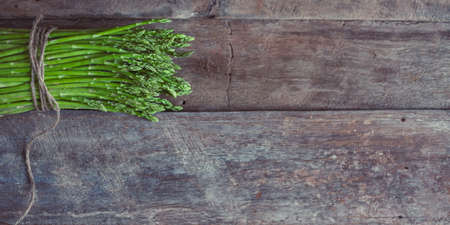Bunch of fresh asparagus on wooden table. Healthy food photo series.