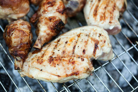 Chiken on the grill - paleo food photography with shallow depth of field.
