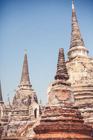 Overview of Ayutthaya temples in Thailand. Ruins of ancient brick walls, old pagoda.
