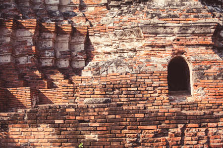 Closeup of ancient brick walls in Ayutthaya temple, Thailand. Perfect ancient geometry.