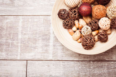 straw twig: Plate in Scandinavian style on wooden background. Copy space at left. Stock Photo