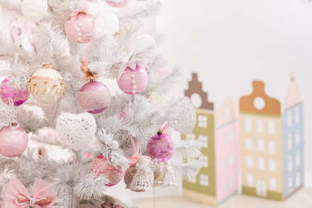 Pink Christmas tree and decorative multicolor houses. Horizontal Stock Photo