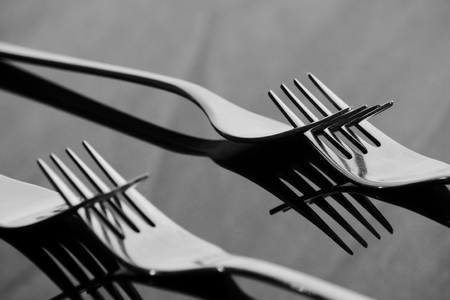 Forks on the glossy table with Reflection Stock Photo