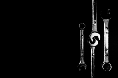 vise grip: Wrench on the black background with hi-contrast monotone and low key style. With copy space.