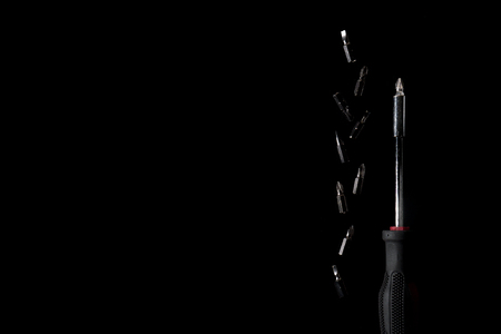 Screwdriver on the black background with hi-contrast and low key style. With copy space. Stock Photo