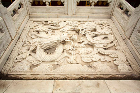 confucian: embossed dragons