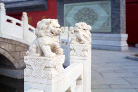 emboss: stone lion sculptures railing