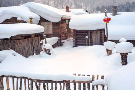 porch scene: village houses  covered with snow Stock Photo