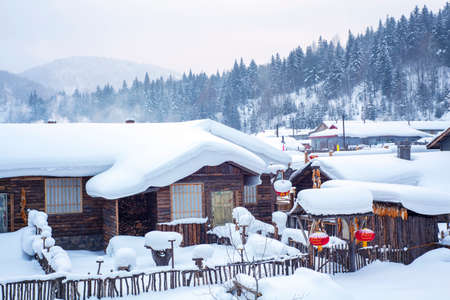 porch scene: village houses  covered with snow Editorial