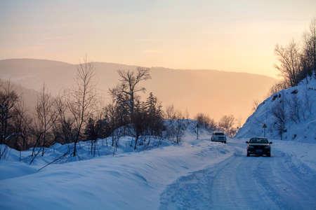 porch scene: cars on snowy road
