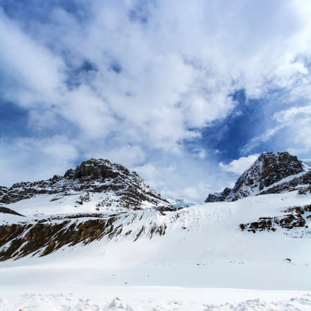 calafate: winter snow capped mountains with blue sky and white clouds