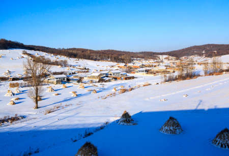 Winter straw white snow cover in rural areas in Northeast China Stok Fotoğraf
