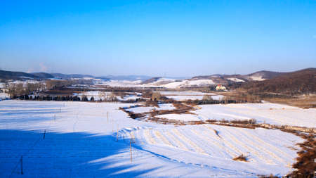 Ice and snow cover of farmland in rural areas of Northeast China in winter Stok Fotoğraf