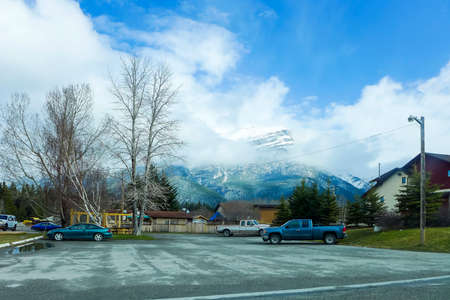 The snowy mountains, blue sky and white clouds in the Canadian Rocky Mountains
