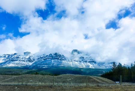 Snowy mountains and blue sky and white clouds in the Canadian Rocky Mountains