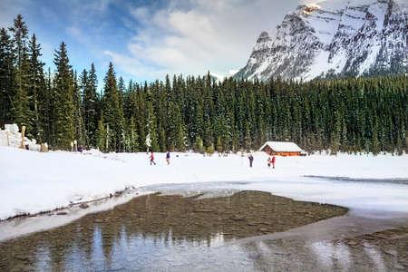 Lewis Lake snow mountain lake water inverted photo cabin
