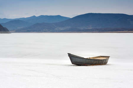 white snow with lake boat
