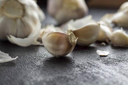 Garlic on wooden background black. - Image