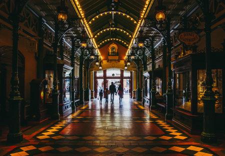 Family walking in Discovery Arcade, Main Street. Disneyland Paris Editorial
