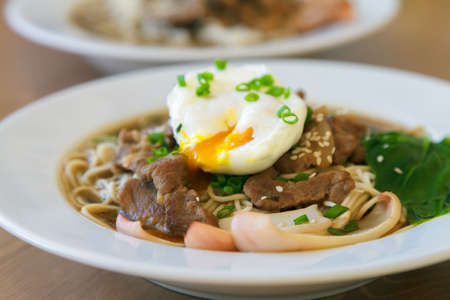 dashi: Udon noodles topped with meat, squid and poached egg