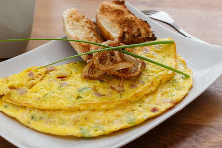 omlet: Denver omelet with fried onion on a plate