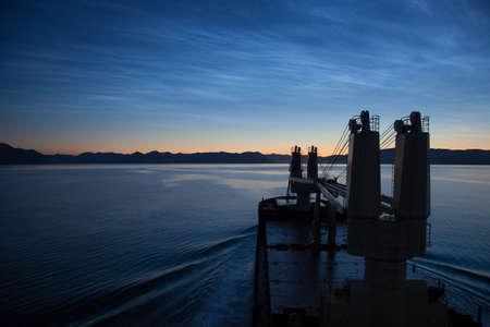 black moor: Cruise ship sailing in Alaska, at dusk